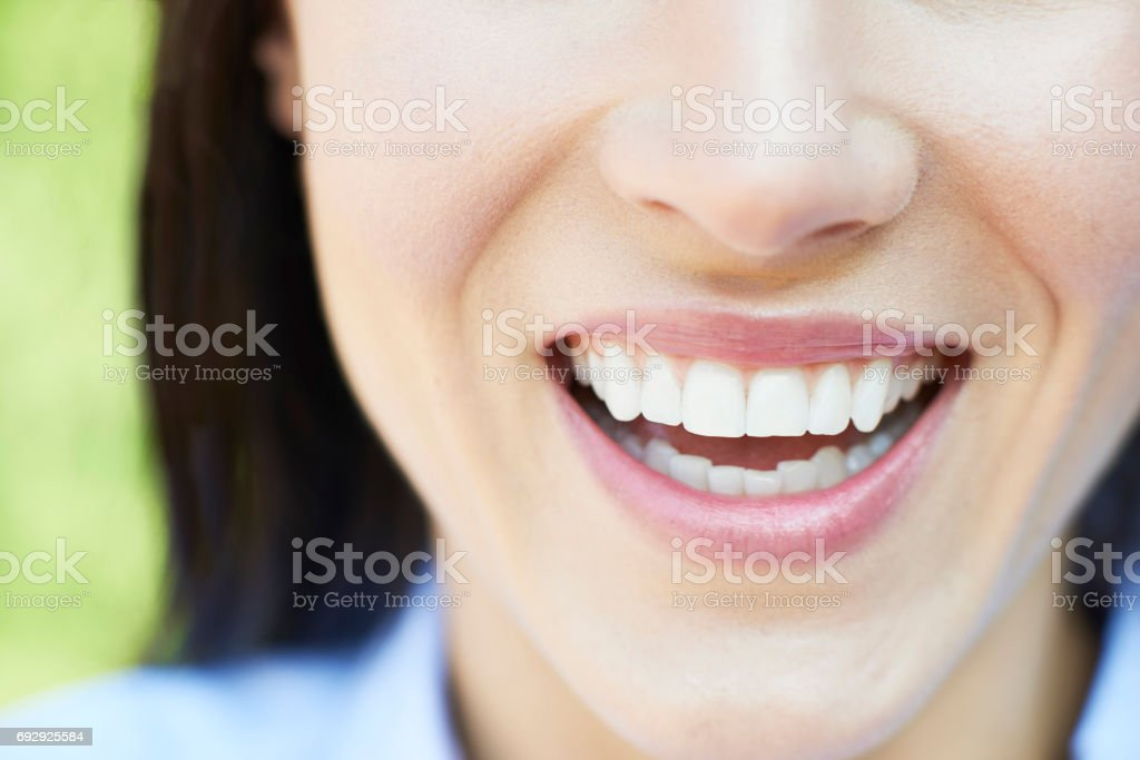 Close Up Of Woman With Beautiful Teeth And A Perfect Smile stock photo