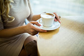 Close up of woman with coffee cup at cafe