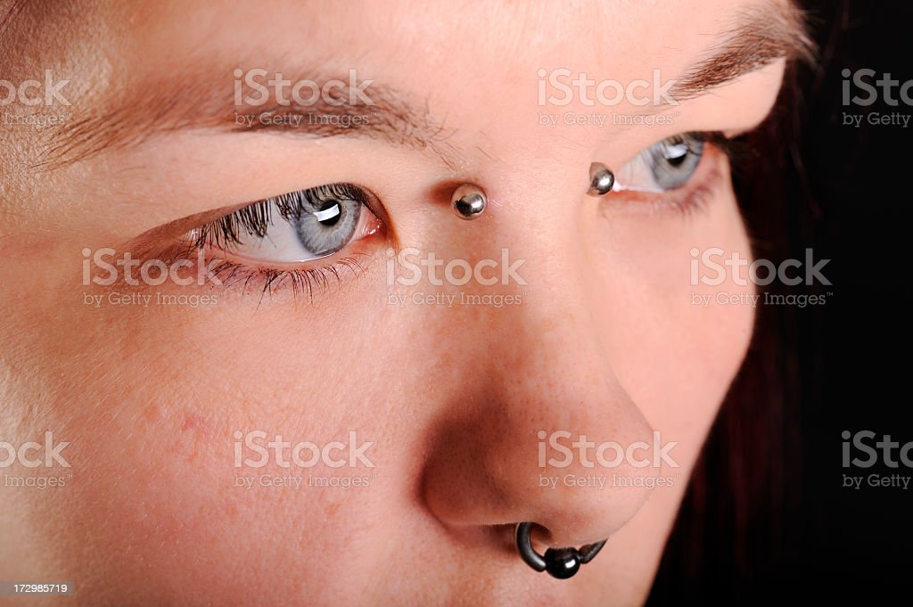 Close up of woman with her nose pierced stock photo