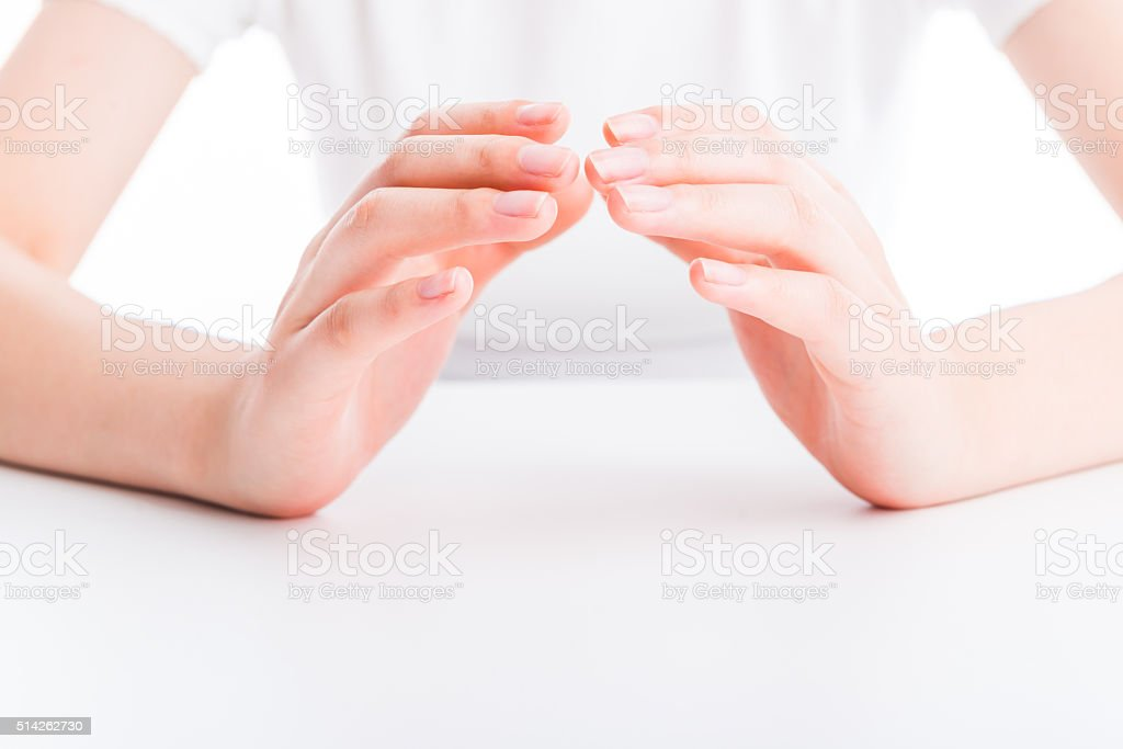 close up of woman's hand protecting something stock photo