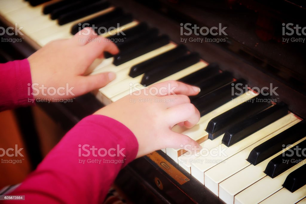 Close up of womans hands playing piano stock photo