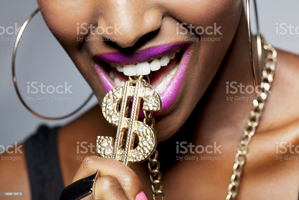 Close Up of Woman's Mouth with Dollar stock photo