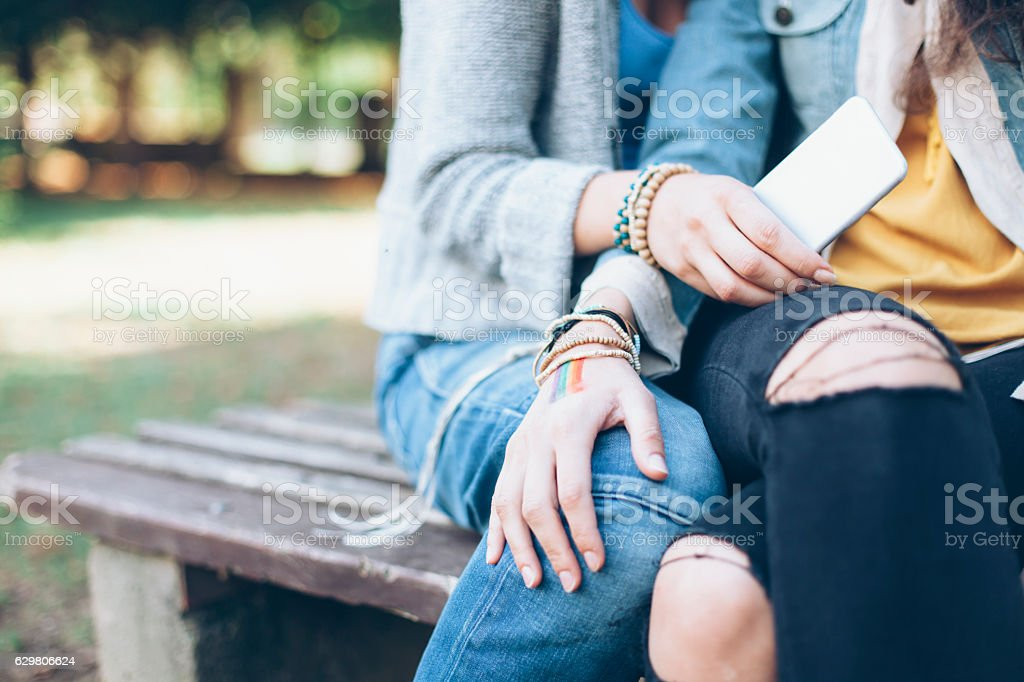 Close up of women sitting on bench and resting stock photo