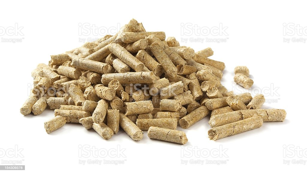 Close up of wood pellets on a white background stock photo