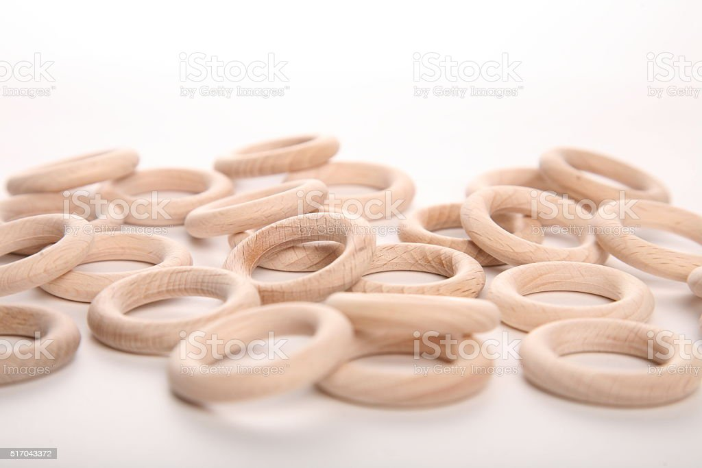 Close up of wooden rings on white background stock photo