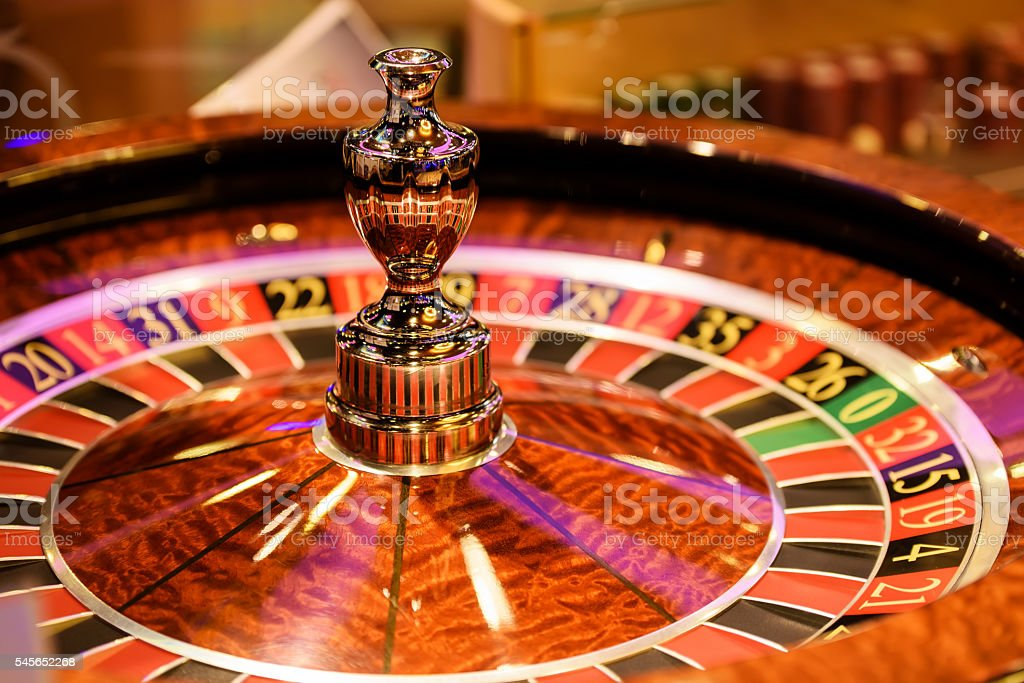 Close up of wooden roulette in casino, selective focus stock photo