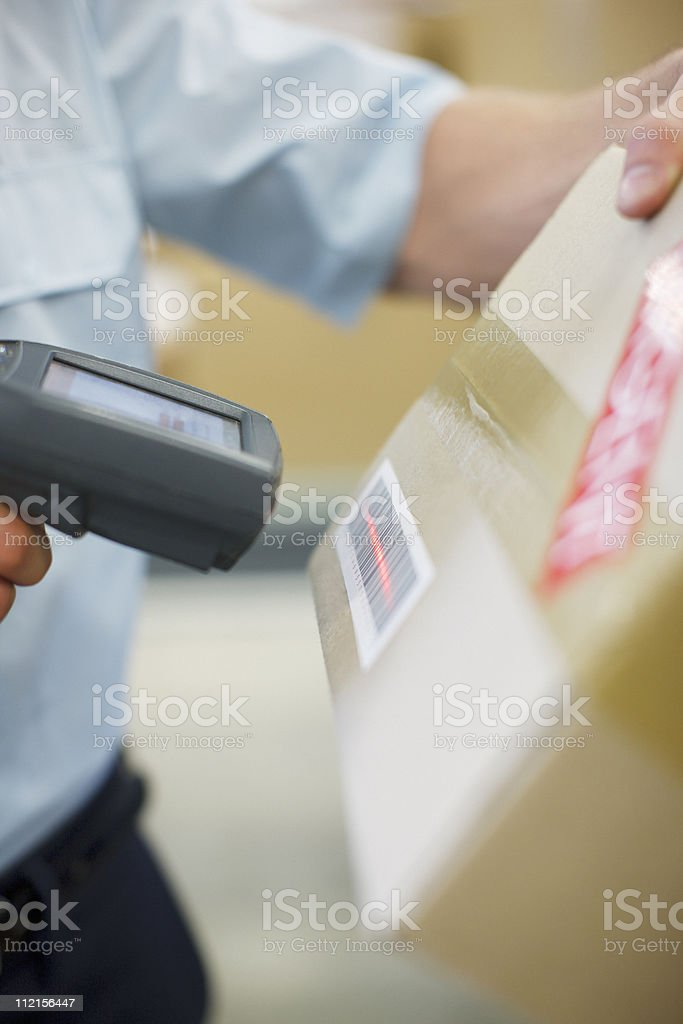 Close up of worker scanning box royalty-free stock photo
