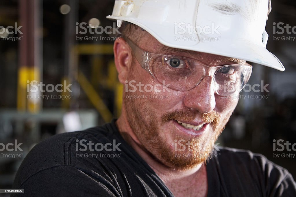 Close up of worker wearing hardhat royalty-free stock photo