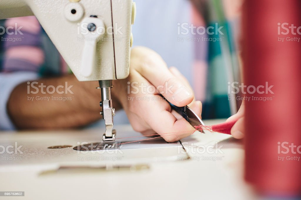 Close up of working tailor stock photo