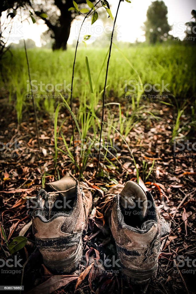 Close up of worn hiking boots, return to nature concept stock photo