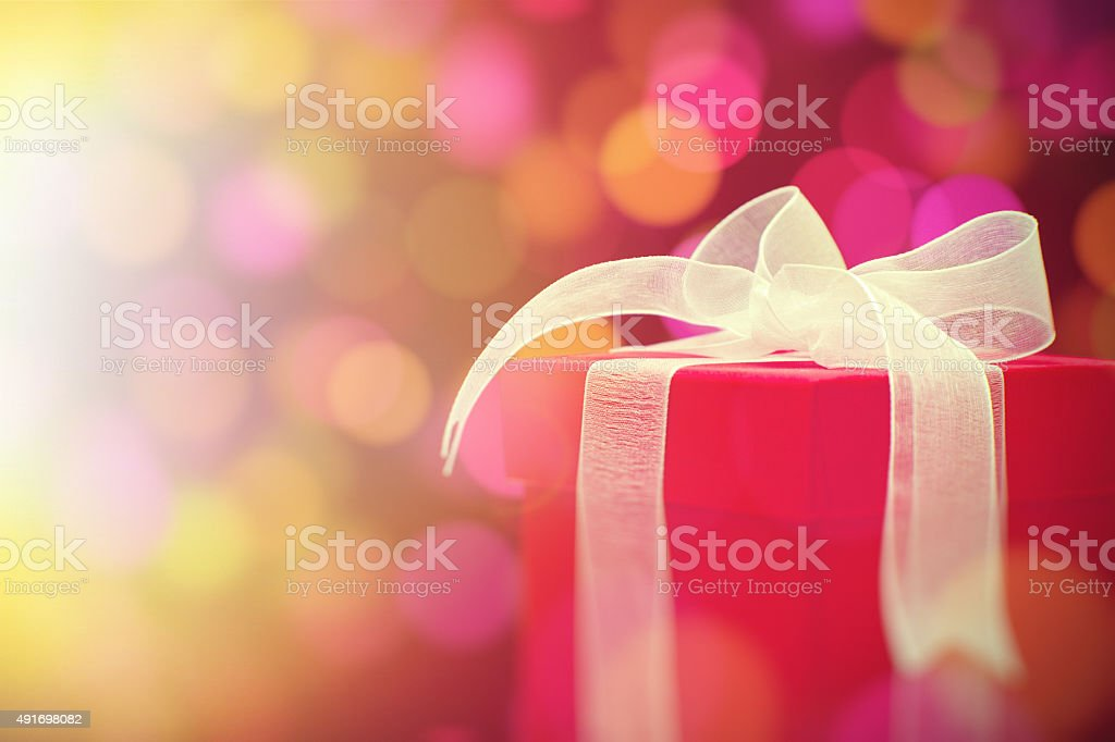 Close up of wrapped Christmas gift stock photo