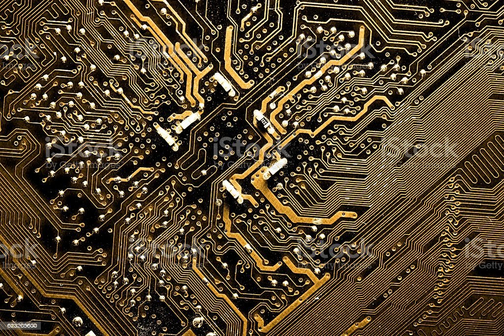Close up of yellow computer circuit board stock photo