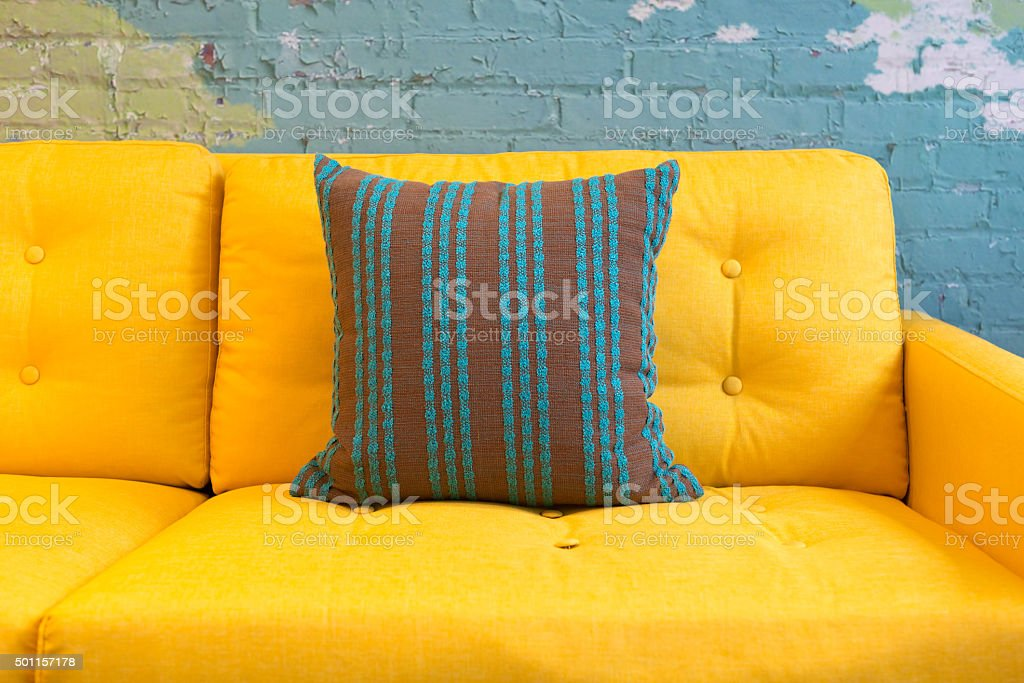 Close up of yellow fabric sofa and cushions stock photo