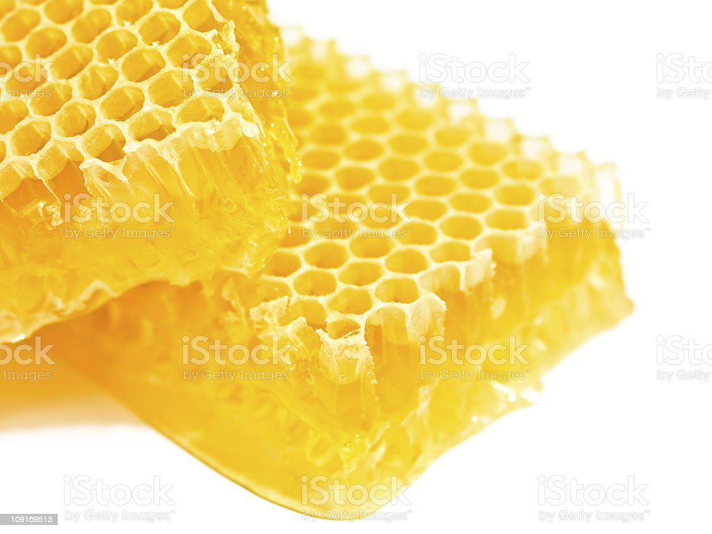 Close up of yellow honeycomb on white stock photo