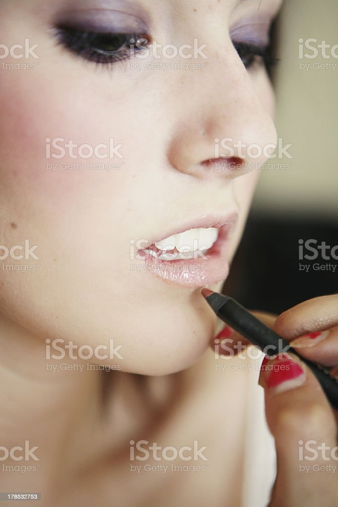 Close Up of Young Girl Getting a Makover royalty-free stock photo
