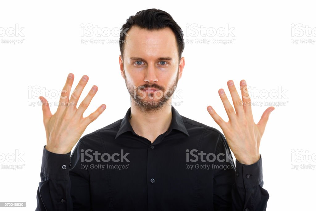 Close up of young handsome businessman showing the back of both hands stock photo