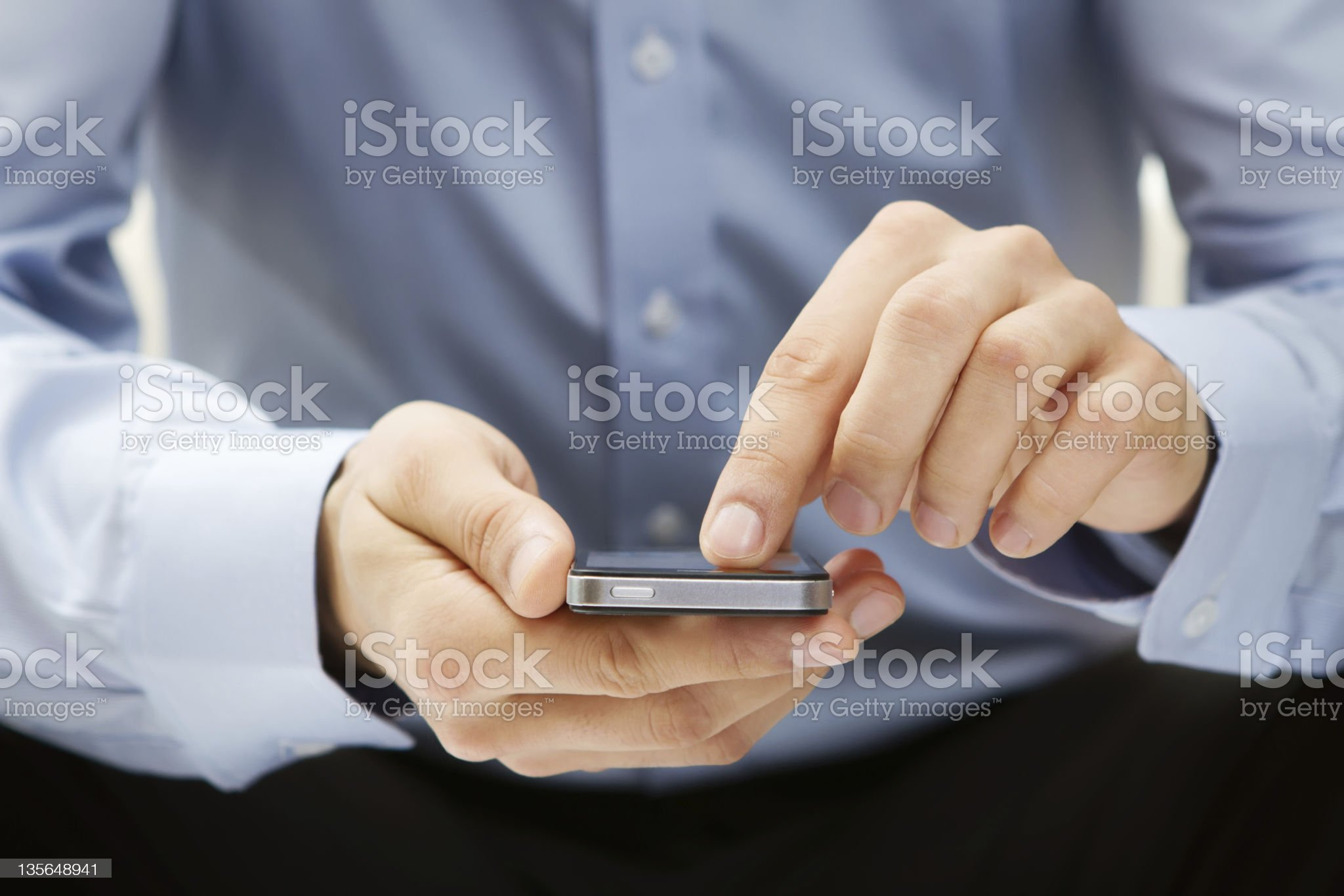 Close up of young man using a smart phone royalty-free stock photo