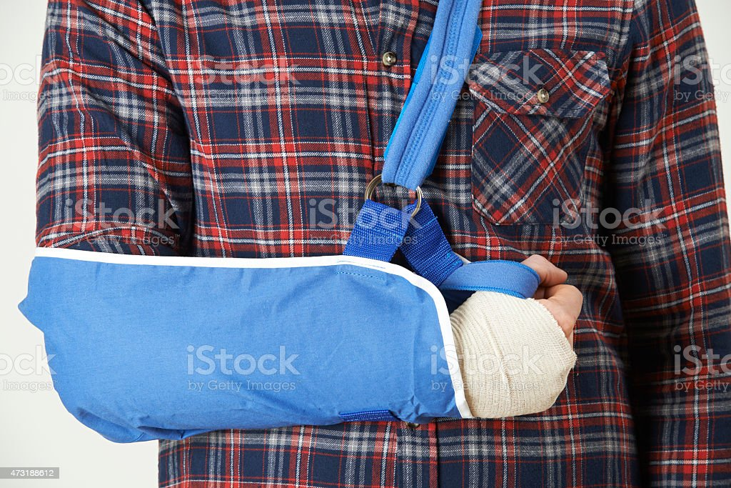 Close Up Of Young Man With Arm In Sling stock photo