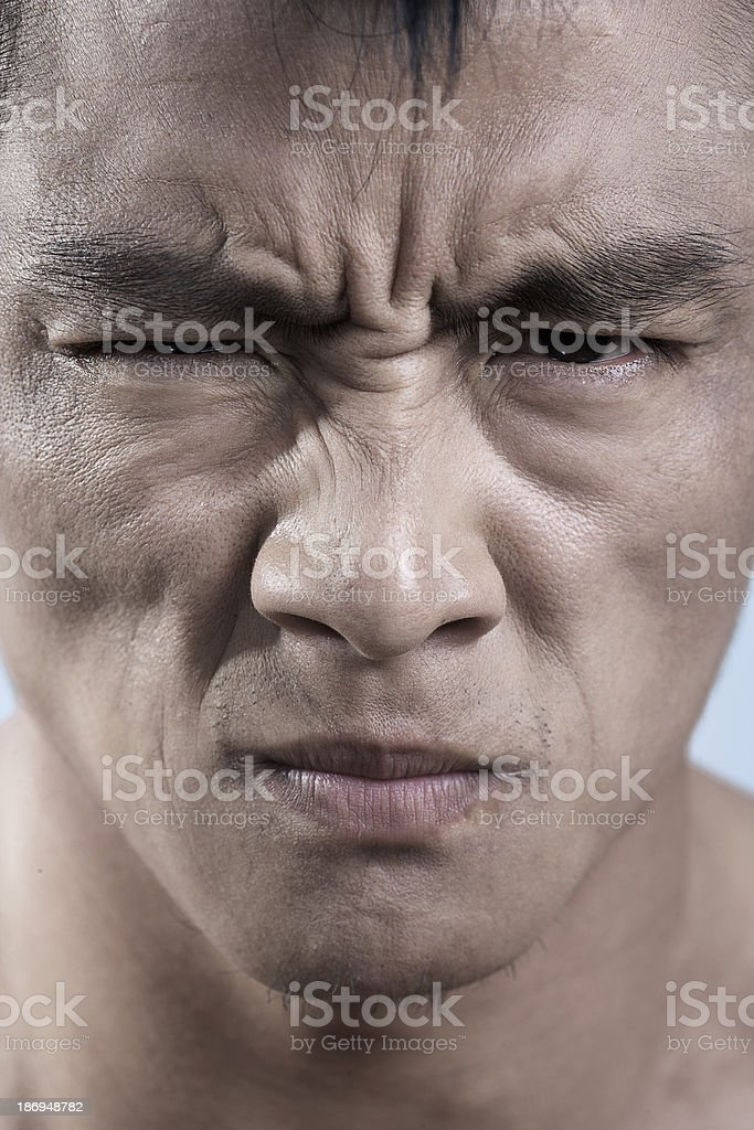 Close up of young mans face, irritated royalty-free stock photo