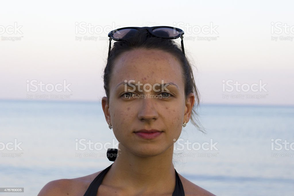 Close up of young pensive woman relaxing in Greece  beach stock photo