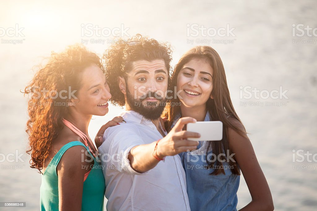 Close up of young people making selfie stock photo