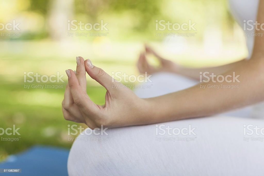 Close up of young woman meditating stock photo