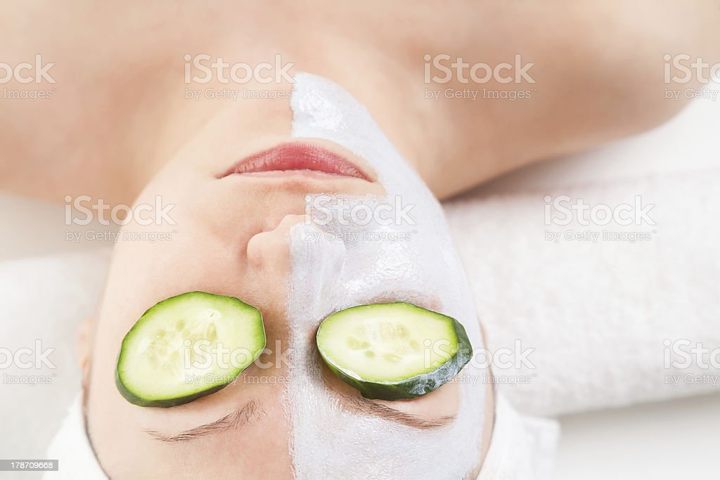 Close up of young woman relaxing while getting spa treatment royalty-free stock photo