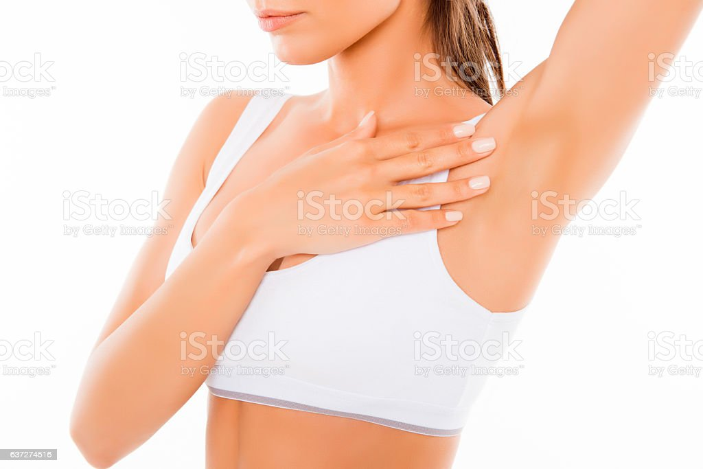 Close up of young woman showing her smooth armpit stock photo