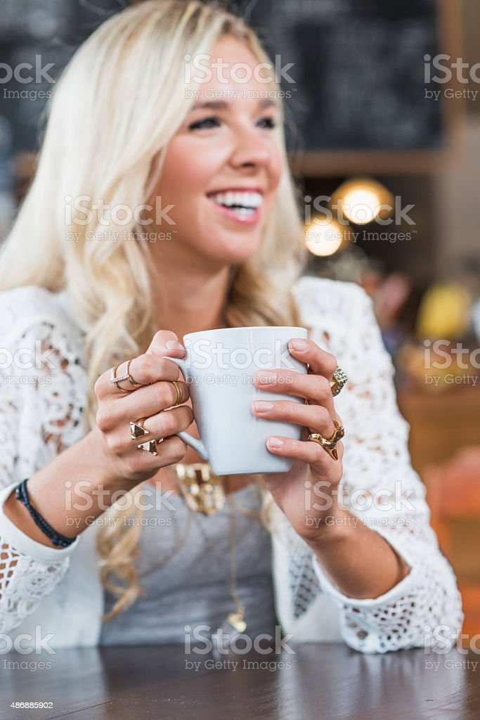 Close up of young woman with cup of coffee stock photo