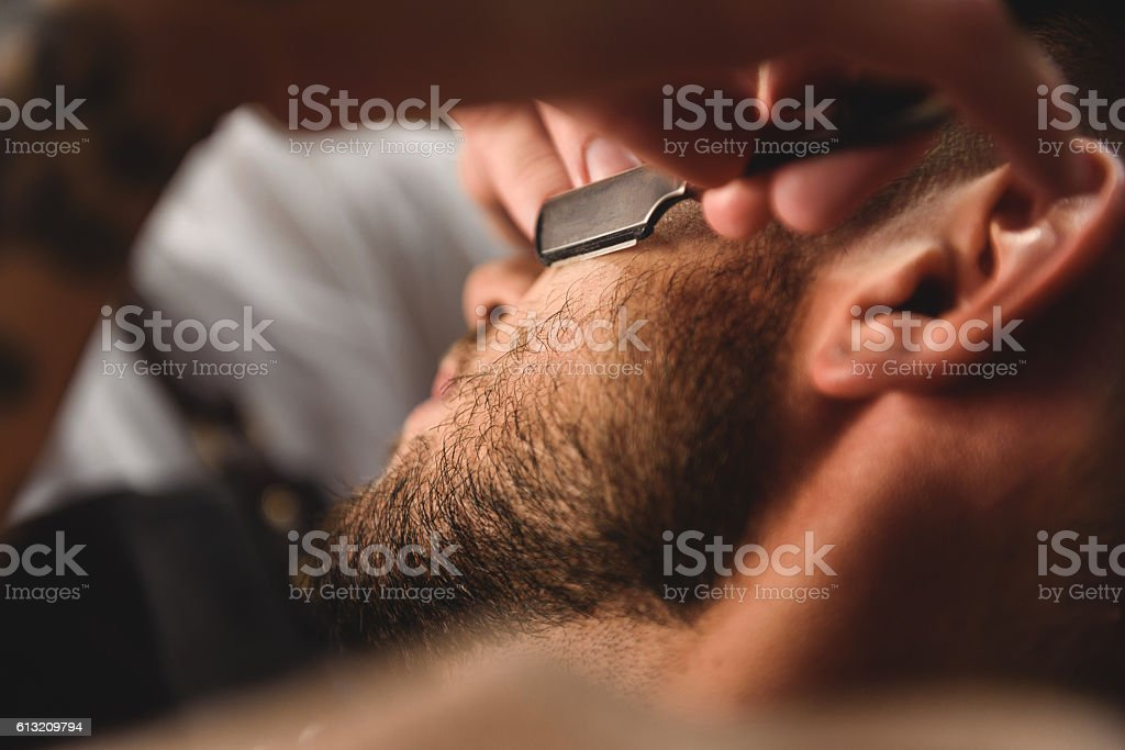 close up old razor in hands of specialist stock photo