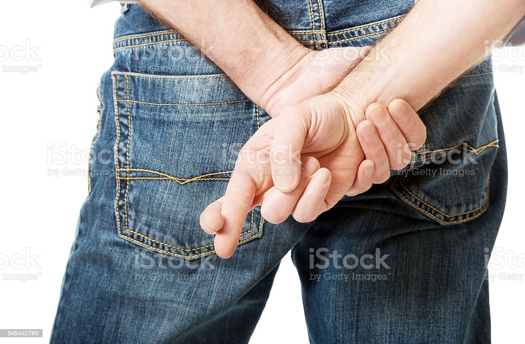 Close up on a man with crossed fingers stock photo