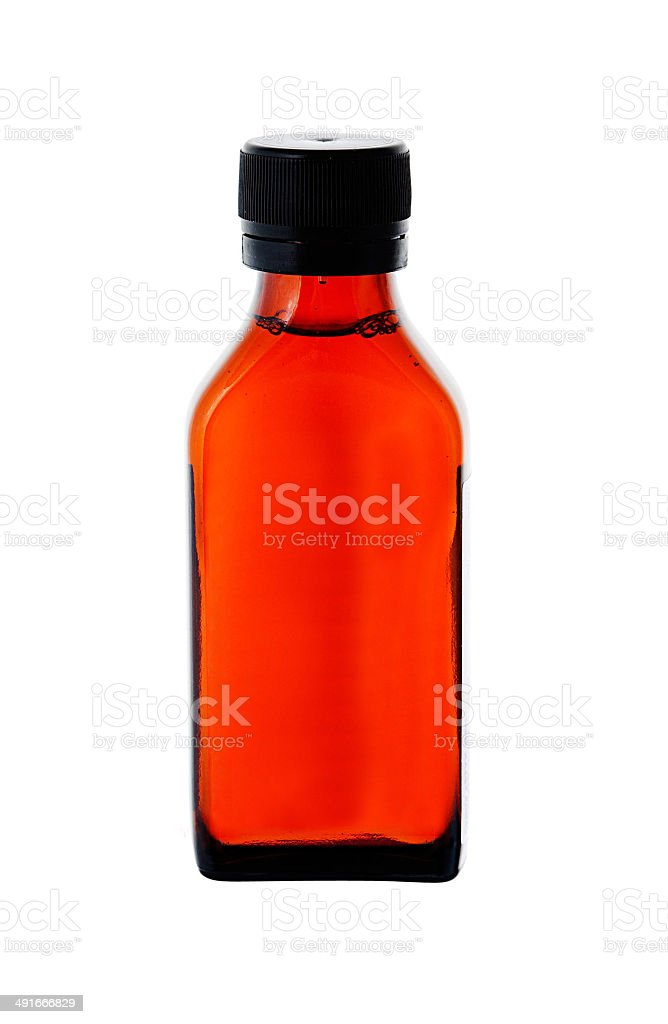 Close up on a medicine bottle with red syrup isolated stock photo
