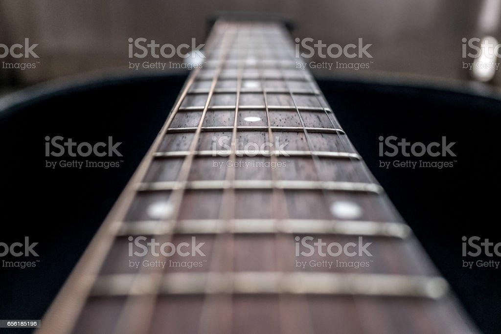 Close up on an acoustic guitar stock photo