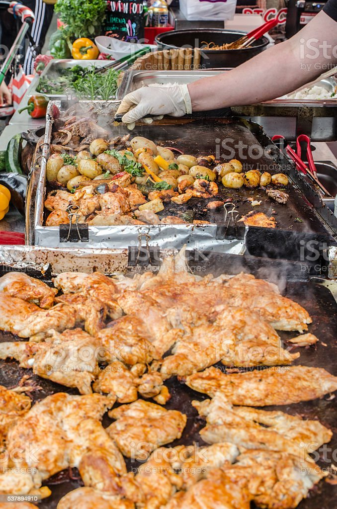 Close up on BBQ chicken potatoes in exterior Camden canteen stock photo