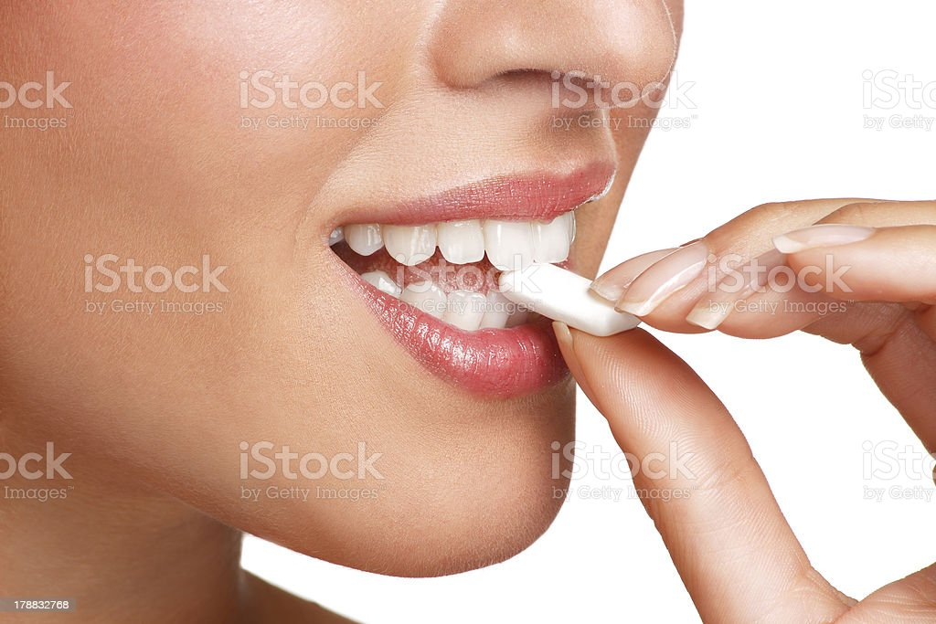 close up on  beautiful girl while enjoying a candy stock photo