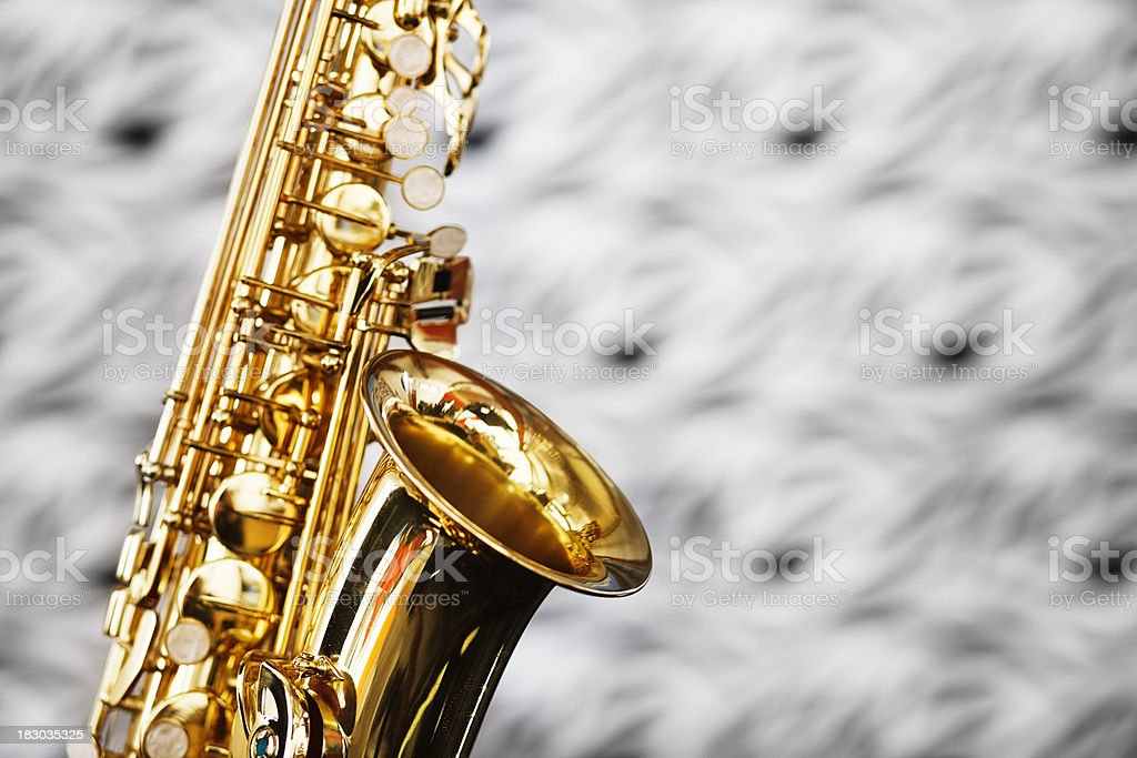 Close up on bell of saxophone against unfocussed bacground stock photo