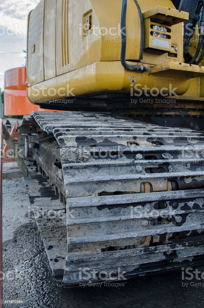 Close up on contstruction caterpillar machinery wheels stock photo