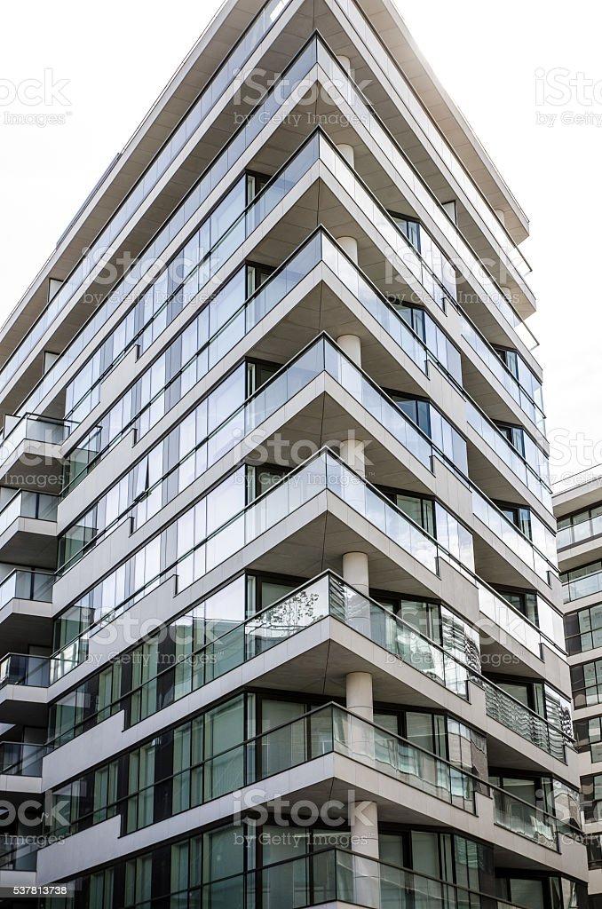 Close up on empty condominium corner to show pointed balconies stock photo