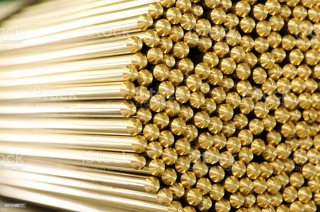 Close up on ends of brass rods stock photo