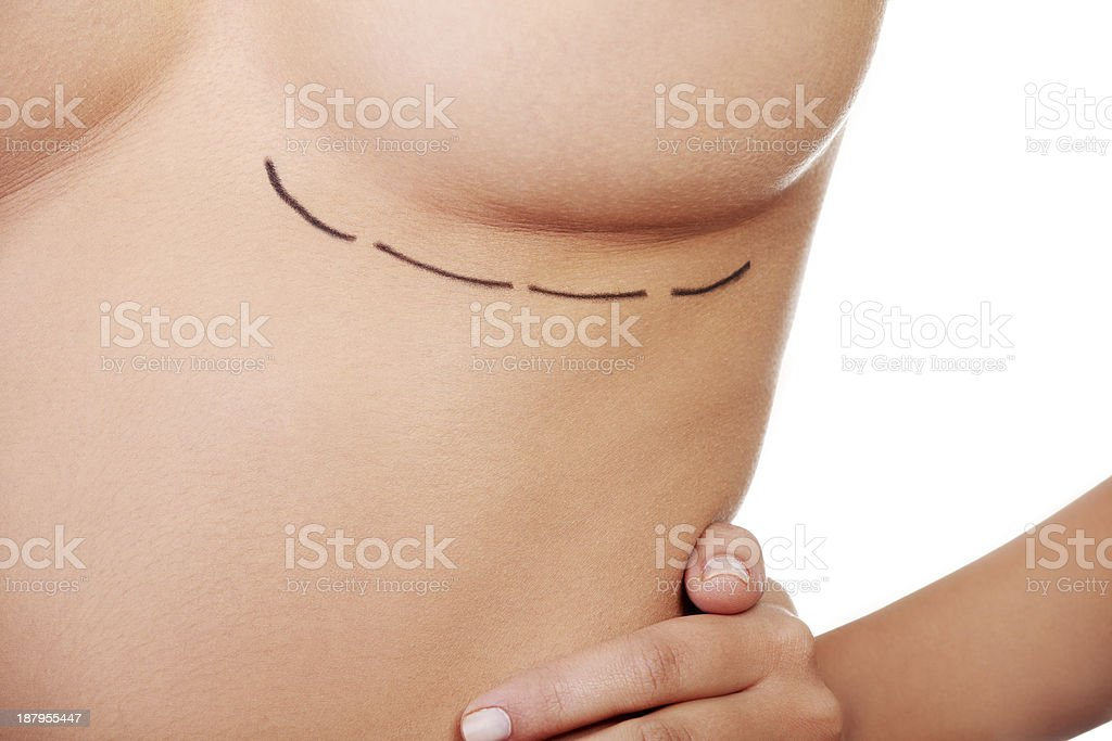 Close up  on female's breast drawn in lines. stock photo