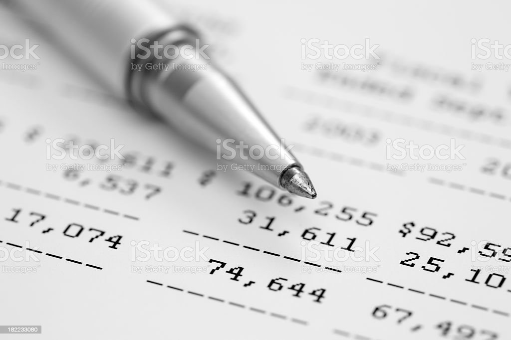 Close up on financial information and a pen royalty-free stock photo
