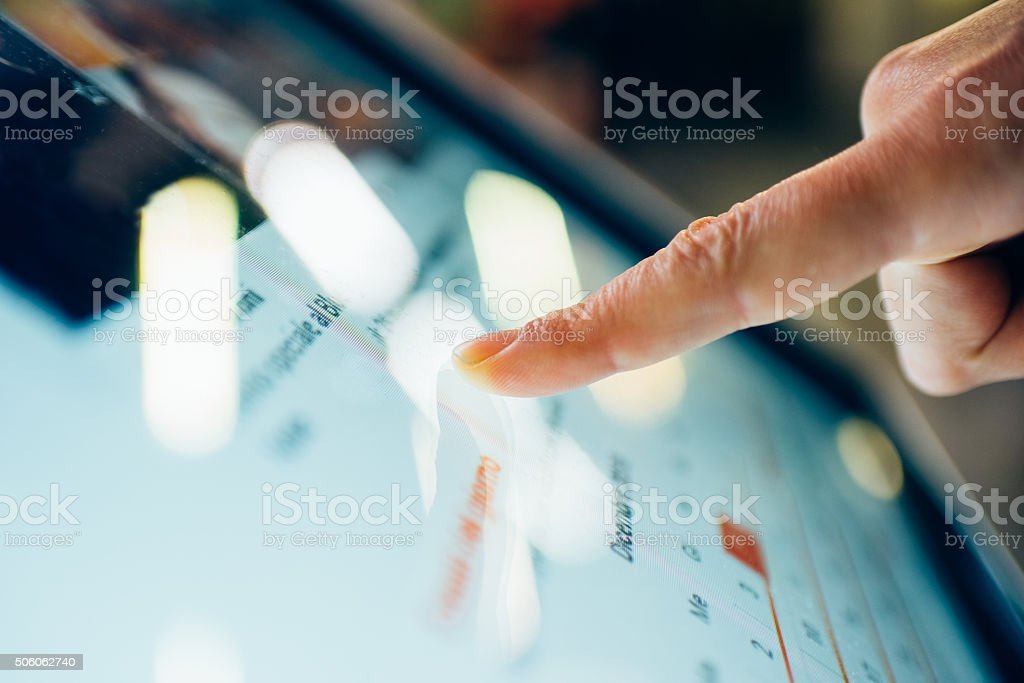 Close up on finger touching the screen of a tablet stock photo