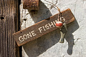 close up on gone fishing sign