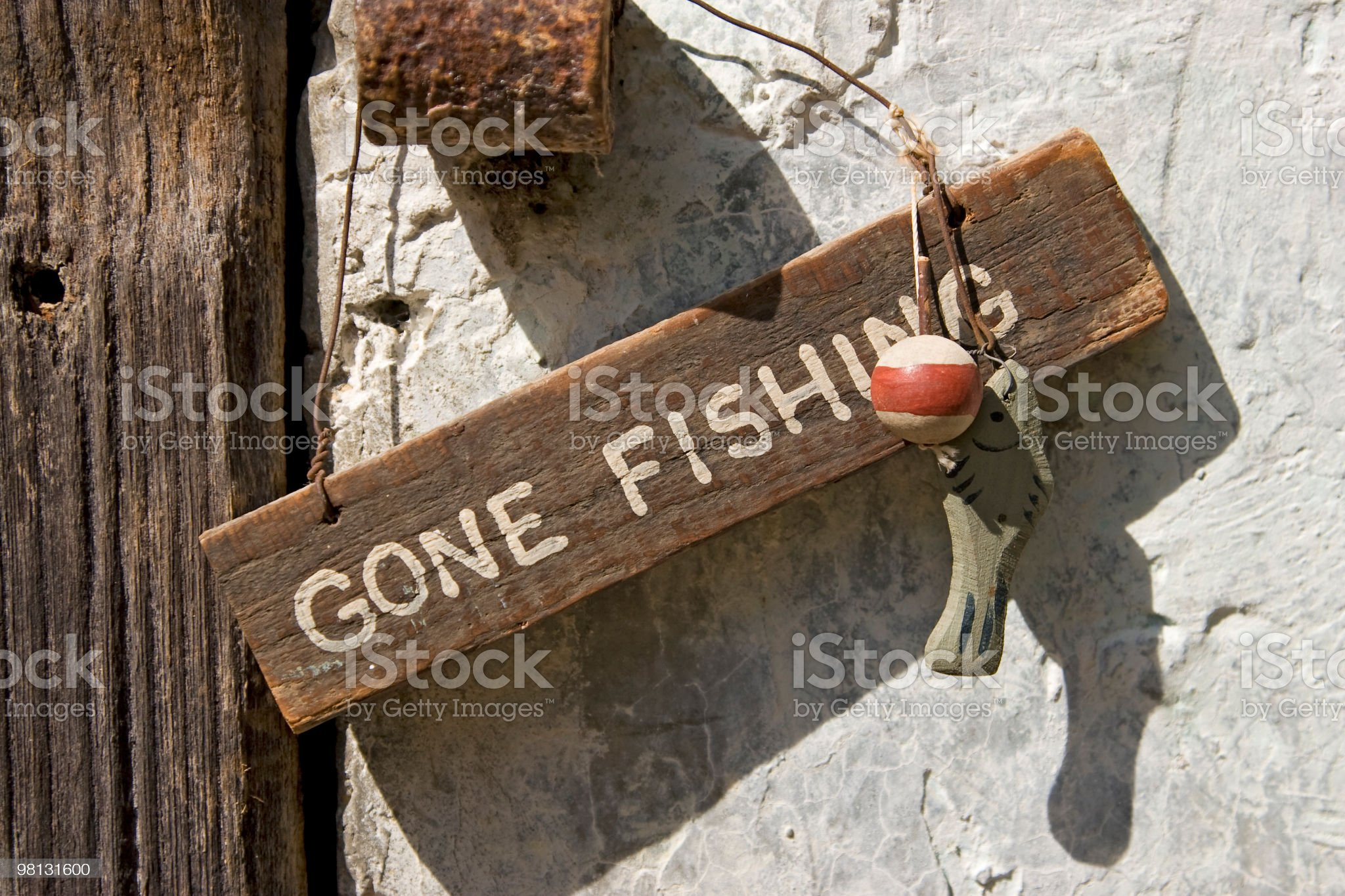 close up on gone fishing sign royalty-free stock photo