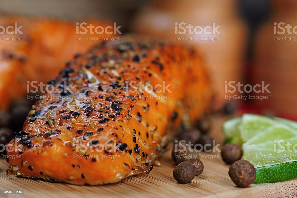 Close up on grilled salmon with pepper stock photo