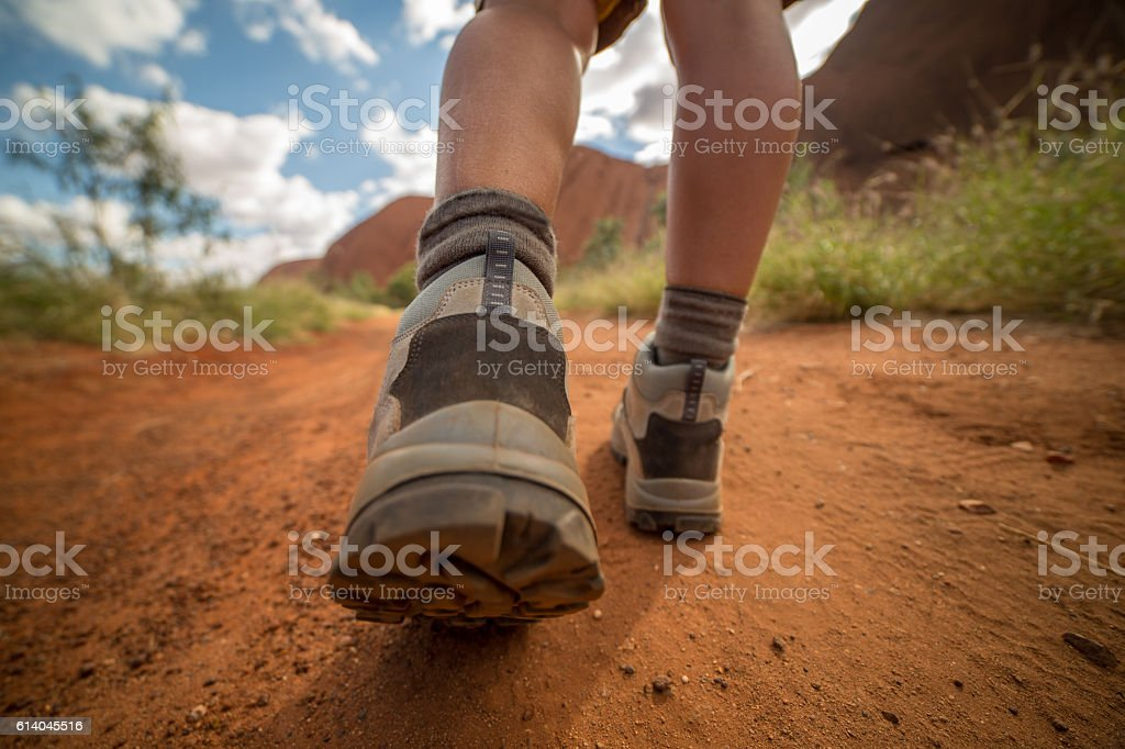 Close up on hiker's boots walking stock photo