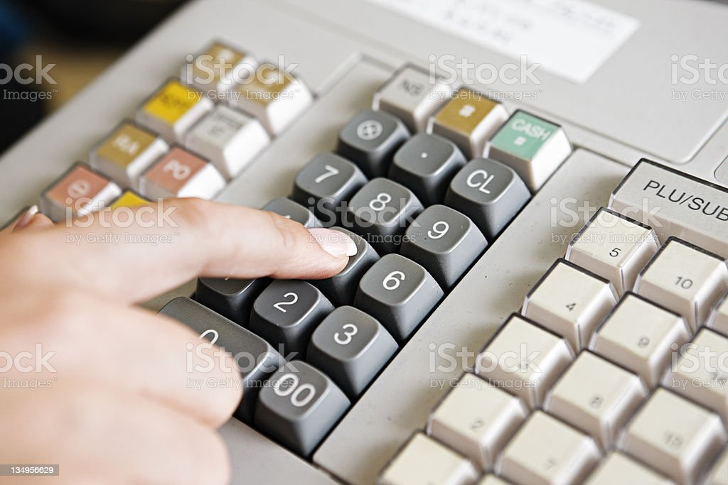Close up on keypad of cash register being operated royalty-free stock photo
