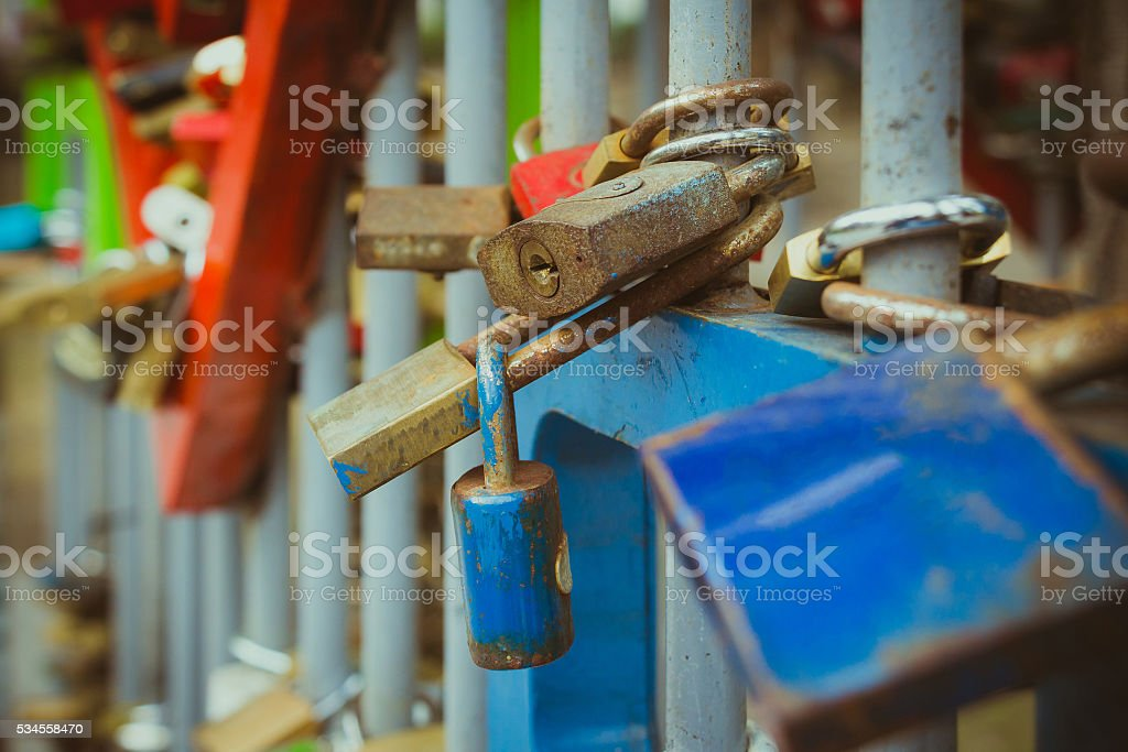 Close up on many love locks on fence stock photo