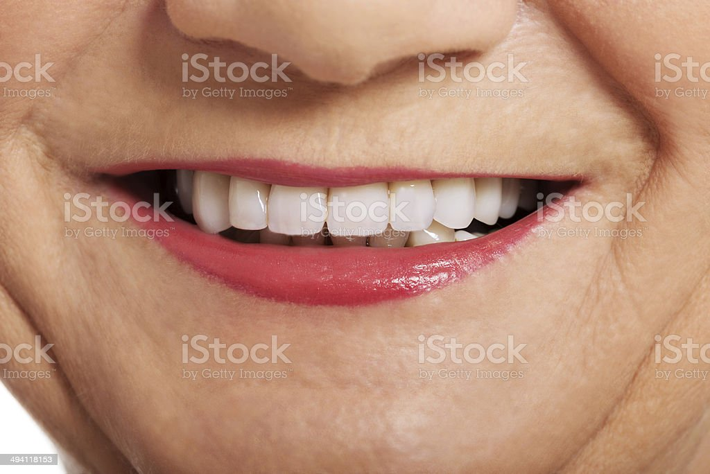 Close up on ol woman's smile, teeth. stock photo