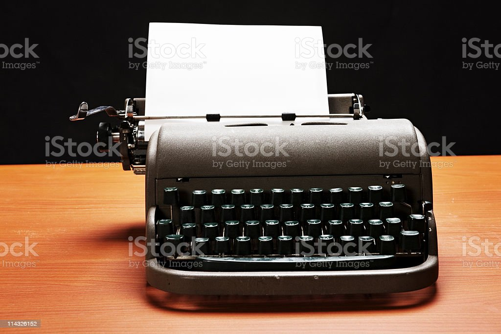 Close up on retro manual typewriter with blank paper royalty-free stock photo